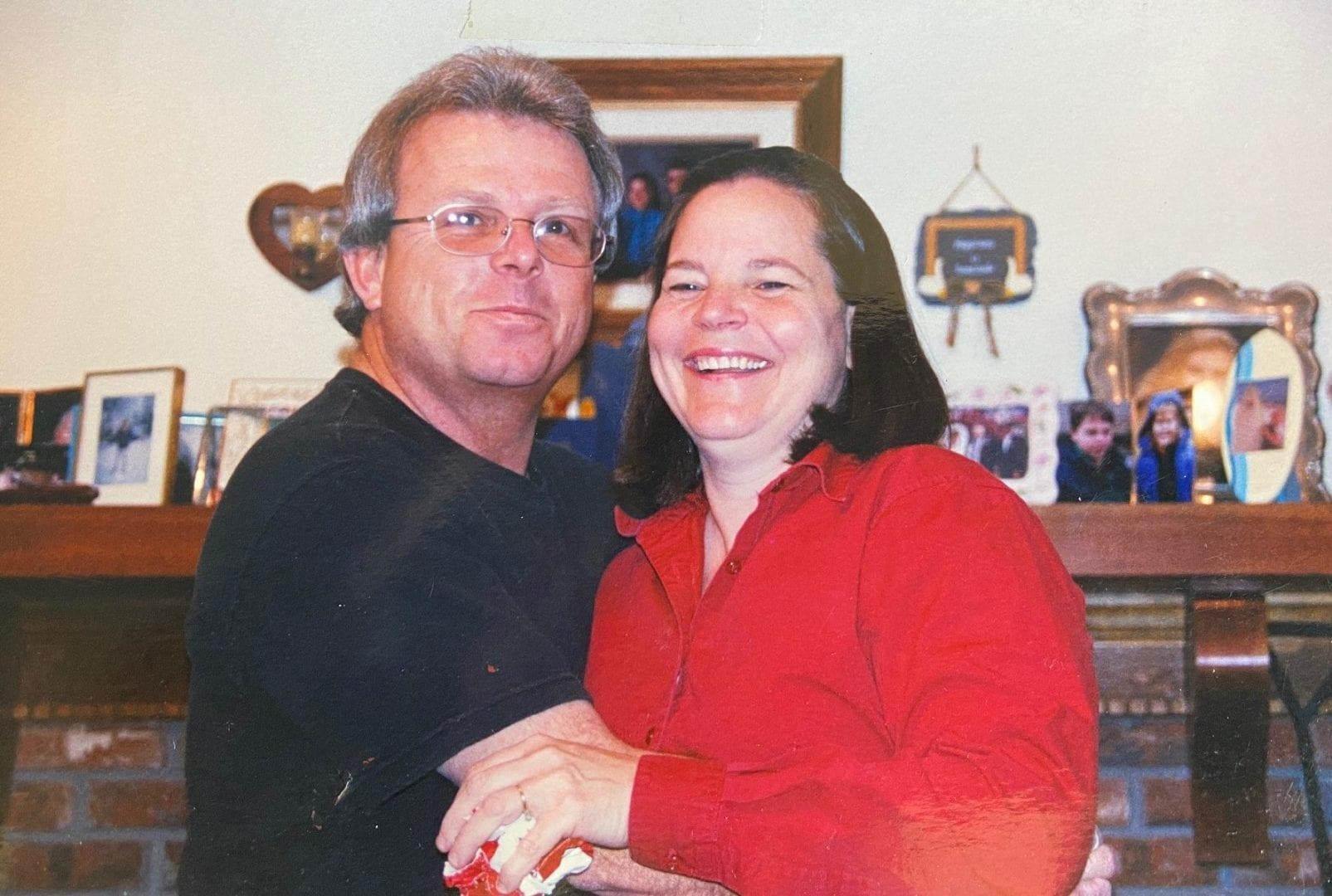 Jamie's Mom and Dad Hugging at Christmas - Happier Holidays at Home