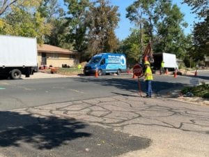 Replacing my sewer line - flaggers in the road directing traffic